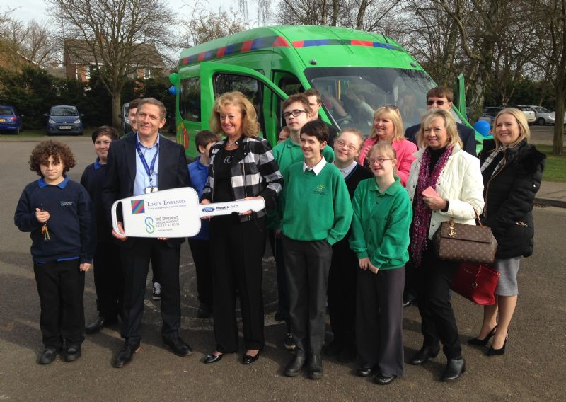 Staff and pupils receiving the new Lord's Taverners minibus